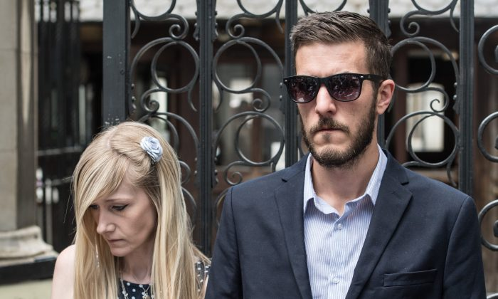 Chris Gard and Connie Yates, the parents of terminally ill toddler Charlie Gard, listen as a family friend addresses the media outside High Court on July 10, 2017 in London, England. A lawyer for Great Ormond Street Hospital has dismissed claims of new medical evidence in the case of the terminally ill baby after the hospital referred the case back to the High Court after reports of new data from foreign healthcare professionals suggested treatment could improve his condition. (Carl Court/Getty Images)