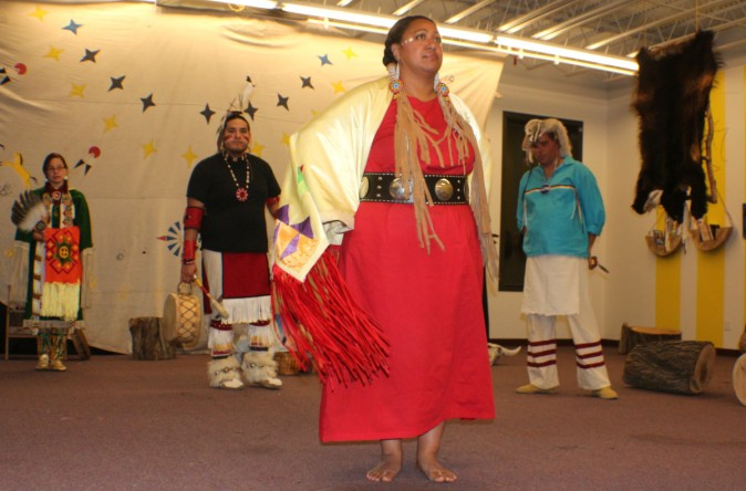 Lakota Ways, teaching visitors different dances and stories of Lakota pople. Kiri Close in Red, Joseph Shopbell on the far right, Tyler One Horn in Black and Adonica Little-Sky on the far left. (Myriam Moran copyright 2014)