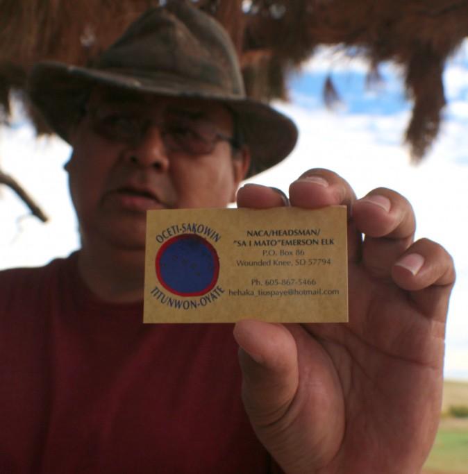Emerson Elk Holding his business card with his Lakota name Sa I Mato Emerson Elk. (Myriam Moran copyright 2014)