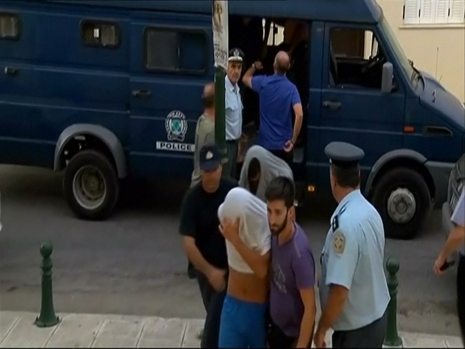 Suspects arrive at Zakynthos courthouse on July 8th after the death of American tourist on July 7th.