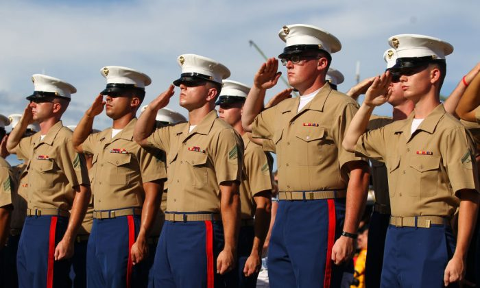 Members of the U.S. Marines stand at attention at an event in North Carolina. (Photo by Sarah Crabill/Getty Images)