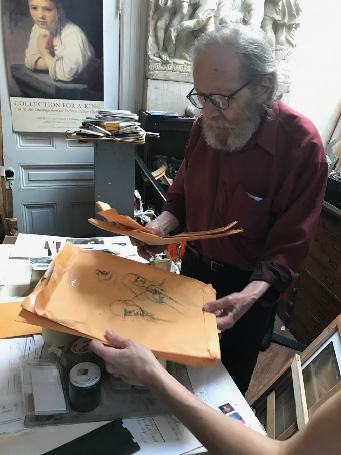 Harvey Dinnerstein shows a recent sketch he made of a cab driver in his studio in Brooklyn, New York, on May 31, 2017. (Milene Fernandez/The Epoch Times)