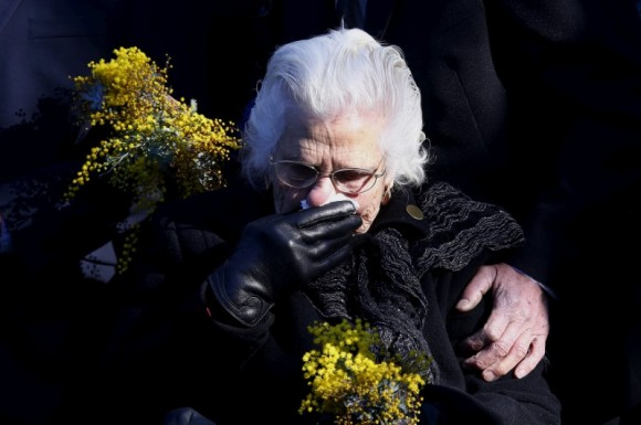 A relative of an Australian victim of Malaysia Airlines jet MH17 reacts before placing a floral tribute at a memorial that was unveiled outside Parliament House in Canberra, Australia, July 17, 2015.   (Reuters/David Gray/File Photo)