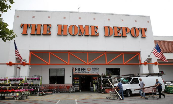 Customers enter a Home Depot store on May 16, 2017 in Redwood City, California. (Photo by Justin Sullivan/Getty Images)