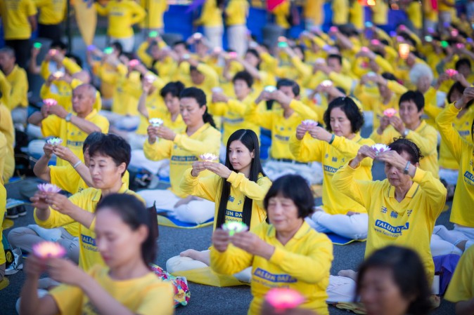 Hundreds of Falun Gong practitioners and supporters hold a candlelight vigil in front of the Chinese Consulate in New York on July 16, 2017. Launched on July 20, 1999, the persecution is now entering its 18th year inside China. (Benjamin Chasteen/The Epoch Times)