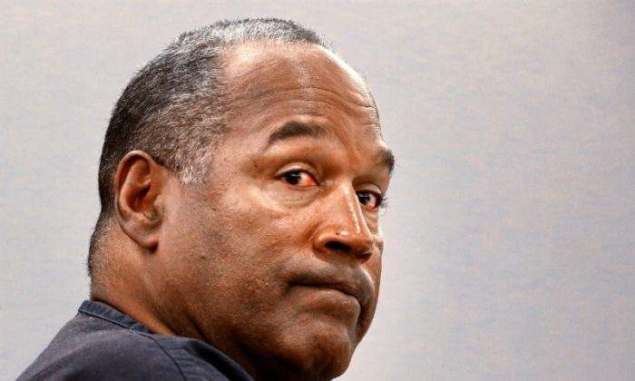 File photo: O.J. Simpson sits  during an evidentiary hearing in Clark County District Court in Las Vegas, Nevada, U.S. on May 16, 2013.   (Reuters/Jeff Scheid/Pool/File Photo)