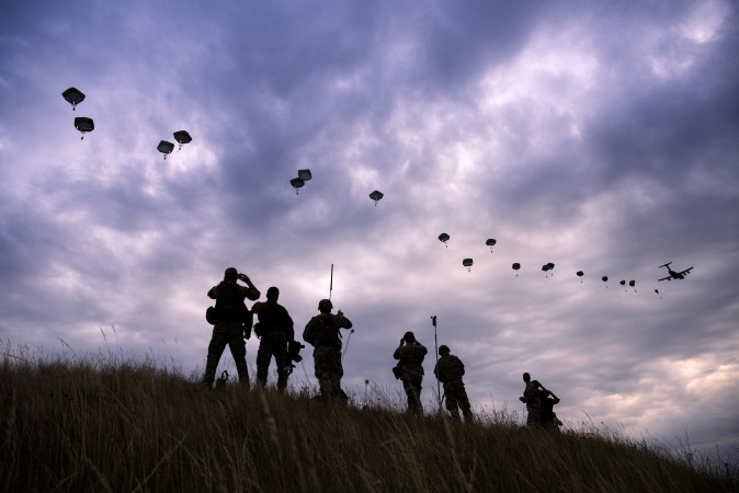 NATO paratroopers drop out of a US Air Force Hercules during the 'Swift Response 17' joint airborn military exercise at Bezmer airfield near the village of Bezmer, Bulgaria, on July 18, 2017. The US led 'Swift Response 17' airborne exercise involves up to 1,600 soldiers from the United States, Canada, Italy, Portugal and Greece. (DIMITAR DILKOFF/AFP/Getty Images)