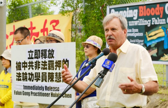 MPP Jack MacLaren speaks at a really across from the Chinese embassy in Ottawa on July 19 to call for an end to the persecution of Falun Gong ordered by the Chinese regime 18 years ago on July 20, 1999. (The Epoch Times)