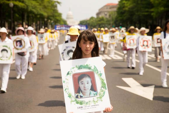 Hundreds of Falun Gong practitioners march in a parade in Washington D.C. on July 20, 2017. The parade is calling for an end to a brutal persecution in China that started on July 20, 1999. (Benjamin Chasteen/The Epoch Times)