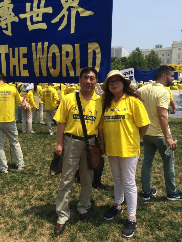 Liu Zhaohe, a former philosophy professor, and his wife Wang Lurui participate in a Falun Gong parade in Washington D.C on July 20, 2017. (Irene Luo/Epoch Times)