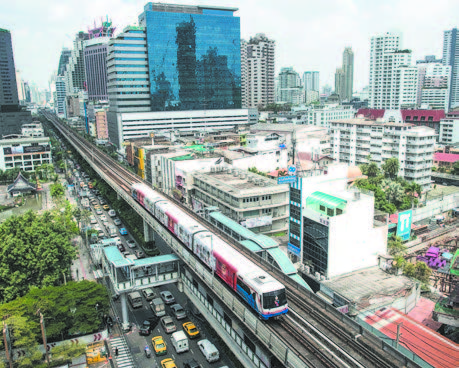 A SKY TRAIN IN BANGKOK ON MARCH 20, 2013. Thailand will borrow a total of $69.5 billion to fund high-speed railways and other transportation mega projects, with most of the money coming from China and Chinese companies providing the construction. Thailand's railways will form part of the Kunming– Singapore railway system. However, Thailand will repay the loans with rice and rubber exports, thus running a trade surplus with China and going against the objective to generate export growth. (NICOLAS ASFOURI/AFP/GETTY IMAGES)
