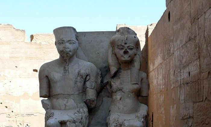 Statues of a young Tutankhamun and his consort Ankesenamun at Luxor Temple, Luxor, Egypt. (Creative Commons )