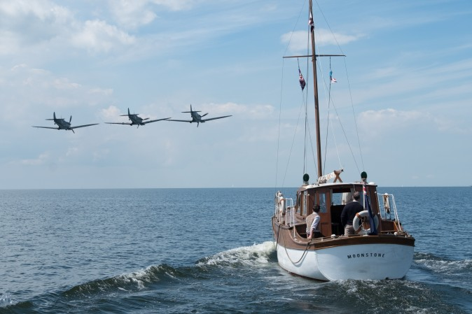 """British warplanes and civilian boats to the rescue in a scene from the Warner Bros. Pictures action thriller """"Dunkirk,"""
