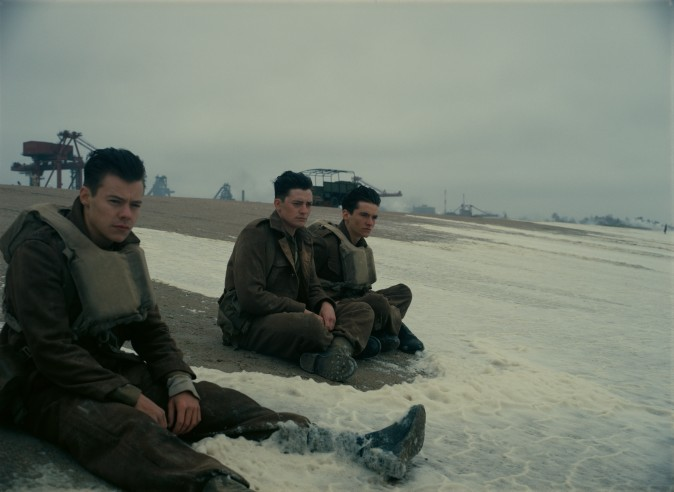 """(L–R) Harry Styles as Alex, Aneurin Barnard as Gibson and Fionn Whitehead as Tommy in the Warner Bros. Pictures action thriller """"Dunkirk,"""