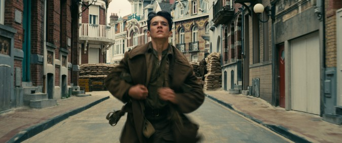 "Fionn Whitehead as Tommy, running for his life in the Warner Bros. Pictures action thriller ""Dunkirk,"