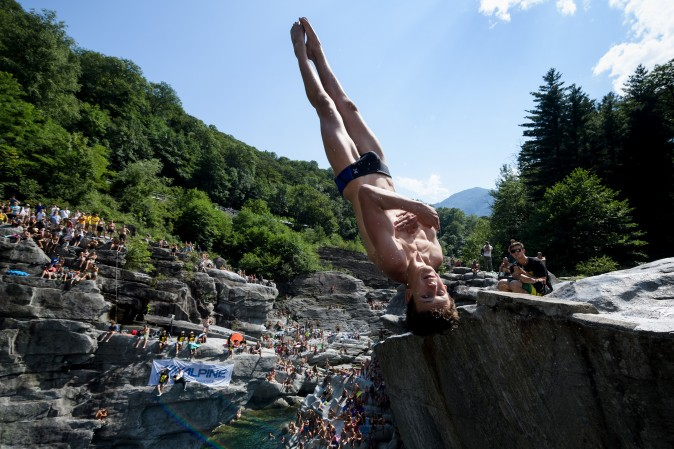 British diver Aidan Heslop competes during the International Cliff Diving Championship in Ponte Brolla, southern Switzerland, on July 22, 2017. Surrounded by steep granite cliffs, the canyon of Ponte Brolla is one of the world's most spectacular natural settings for cliff diving. (FABRICE COFFRINI/AFP/Getty Images)