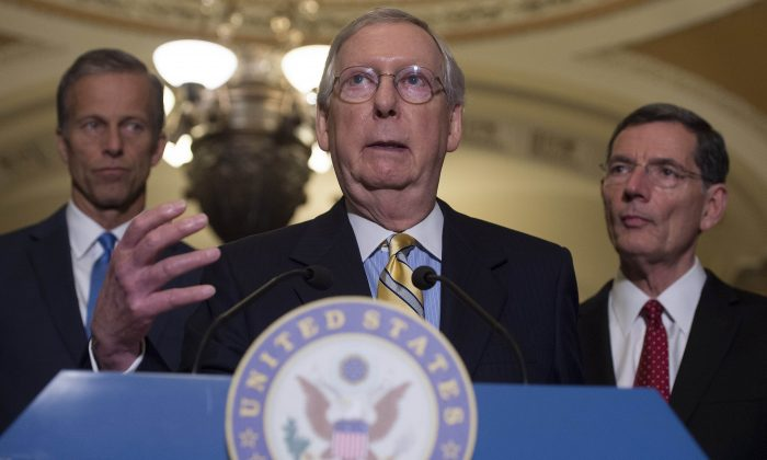 Senate Majority Leader Mitch McConnell (C), (R-Ky), speaks about the Senate Republican's healthcare bill alongside Senator John Thune (L), (R-SD), and Senator John Barrasso (R), (R-Wy), at the US Capitol in Washington, DC, June 27, 2017. (Saul Loeb/AFP/Getty Images)
