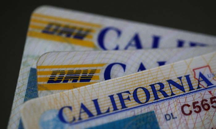 In this photo illustration, the California Department of Motor Vehicles (DMV) logo appears on a California driver license in San Anselmo, Calif. on May 9, 2017. (Photo Illustration by Justin Sullivan/Getty Images)