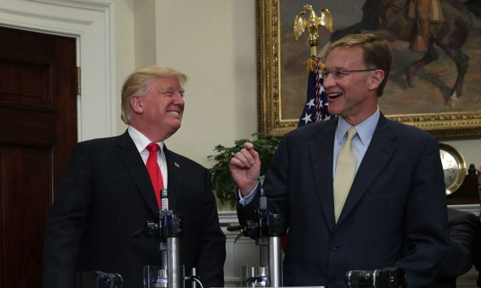 President Donald Trump with Corning CEO Wendell Weeks at the White House on July 20. Trump announced that a joint partnership between Merck, Pfizer, and Corning will bring $4 billion in pharmaceutical glass manufacturing to the United States and create more than 4,000 jobs in the coming years.(ALEX WONG/GETTY IMAGES)