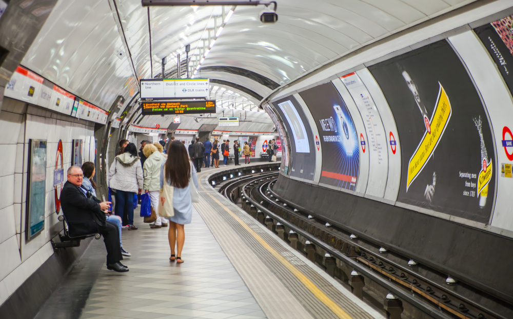 People waiting at underground tube platform for train arrives in England on April 22, 2015. (IR Stone/Shutterstock)