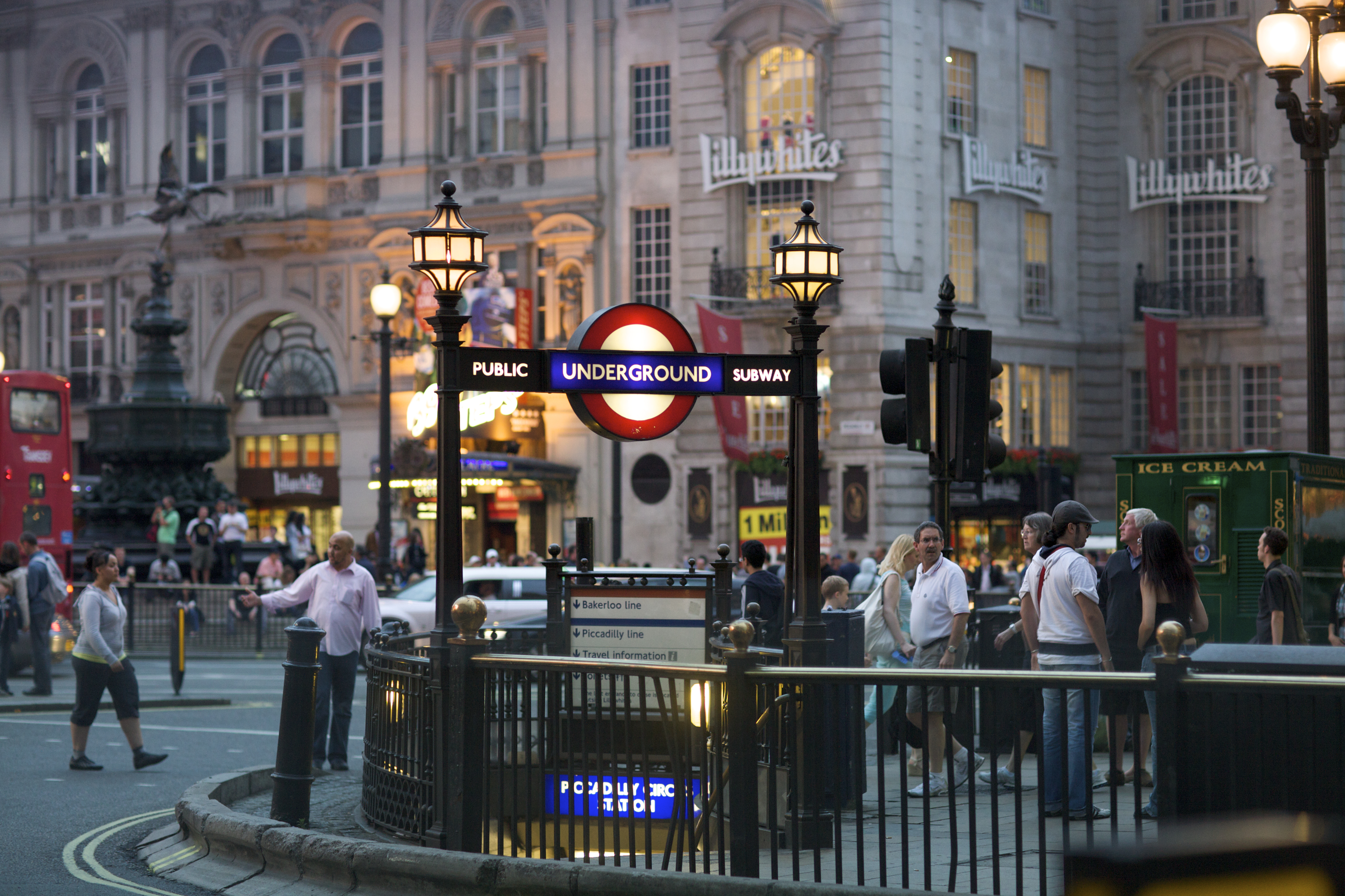 Piccadilly Circus street at night with underground tube station on June 28, 2009 in London, England. London's underground railway is the oldest in the world, dating back to 1863. (Stephen Bures/Shutterstock)