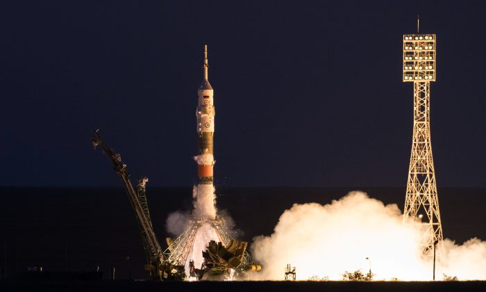 The Soyuz MS-05 rocket is launched with Expedition 52 flight engineer Sergei Ryazanskiy of Roscosmos, flight engineer Randy Bresnik of NASA, and flight engineer Paolo Nespoli of ESA (European Space Agency), Friday, July 28, 2017 at the Baikonur Cosmodrome in Kazakhstan. (NASA/Joel Kowsky)