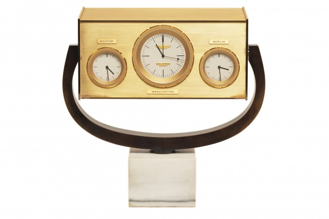 Heinz Wipperfeld and Patek Philippe's autonomous quartz desk clock made for John F. Kennedy (1917–1963) and presented during his visit to West Berlin in June 1963. It showcases the time in Moscow, Washington, and Berlin, to signify a line of direct communication between Washington and Moscow. (Loaned by the John F. Kennedy Presidential Library and Museum in Boston, Massachusetts to Patek Philippe)