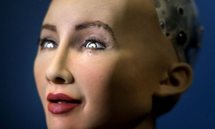 """""""Sophia"""" an artificially intelligent (AI) human-like robot on June 7, 2017, in Geneva. (FABRICE COFFRINI/AFP/Getty Images)"""