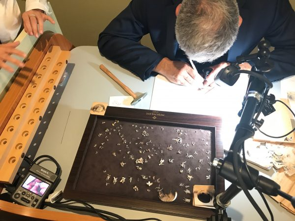"""A marquetry-maker demonstrates his craft at """"The Art of Watches Grand Exhibition"""" of Patek Philippe in New York on July 13, 2017. (Milene Fernandez/The Epoch Times)"""