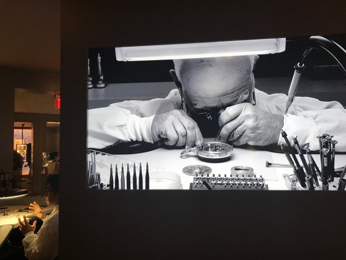 A video of master watchmaker Paul Buclin is shown in the watchmakers room of The Art of Watches Grand Exhibition of Patek Philippe in New York on July 21, 2013. (Milene Fernandez/The Epoch Times)