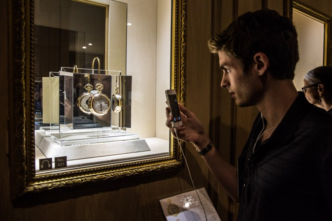 A man takes a photograph of The Calibre 89, in the Museum Room of Patek Philippe's The Art of Watches Grand Exhibition inside Cipriani 42nd Street in New York on July 19, 2017. (Benjamin Chasteen/The Epoch Times)