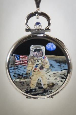 """Patek Philippe's wood marquetry miniature enameling pocket watch. Reference 995/102G–""""First Steps on the Moon.""""  (Benjamin Chasteen/The Epoch Times)"""