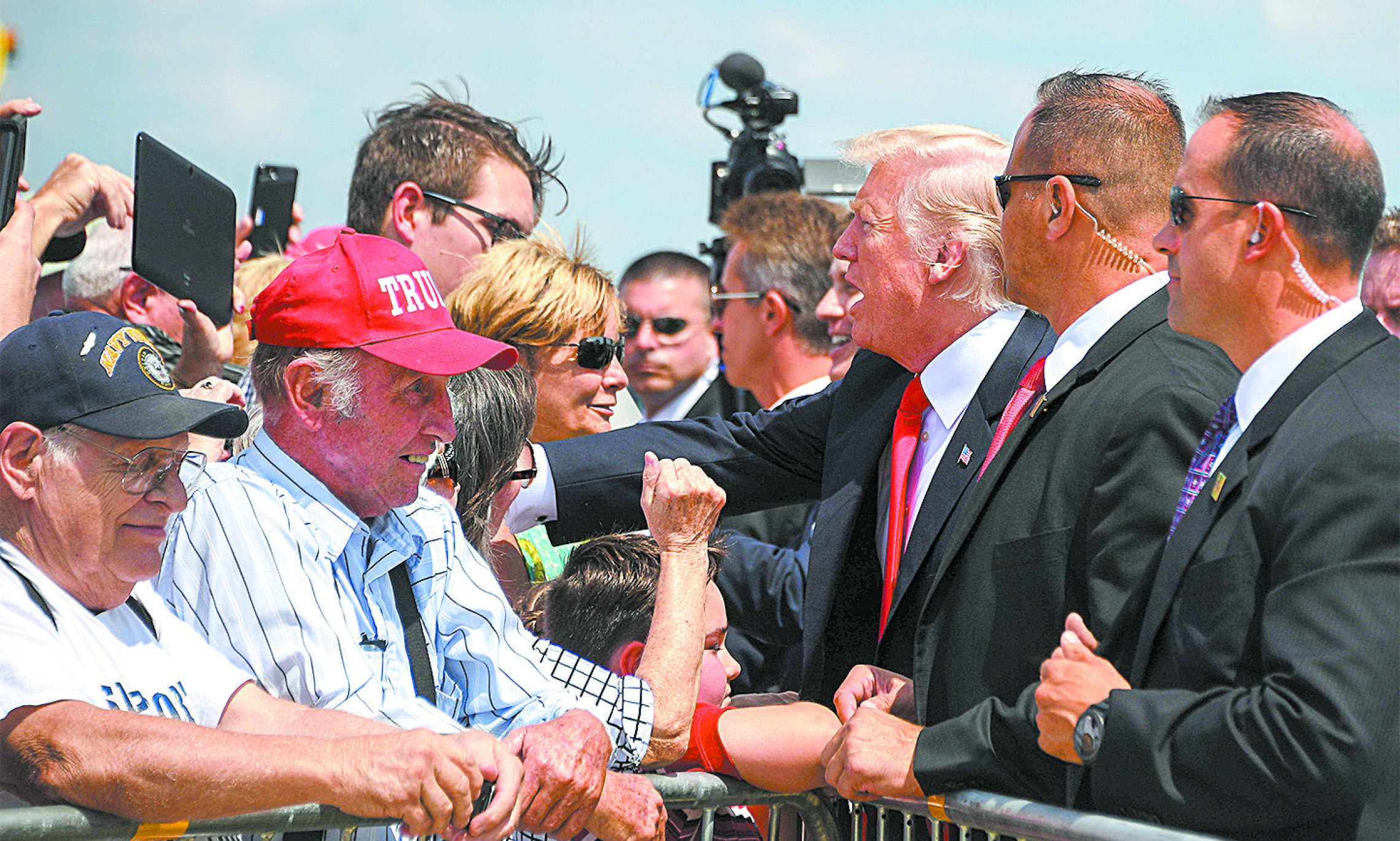 President Donald Trump greets supporters as he arrives in Springfield, Mo., on Aug. 30. (JIM WATSON/AFP/GETTY IMAGES)
