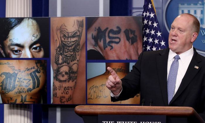 Tom Homan, director of Immigration and Customs Enforcement, at a White House press briefing in Washington, D.C., on July 27. In the background are MS-13 gang-related images. (Win McNamee/Getty Images)