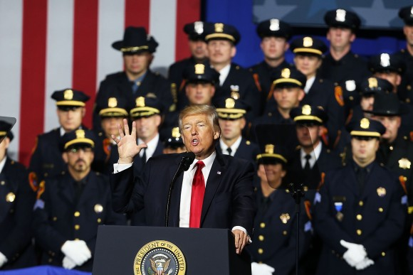 President Donald Trump speaks at Suffolk Community College on July 28, 2017, in Brentwood, New York. Trump, speaking close to where the violent street gang MS-13 has committed a number of murders, urged Congress to dedicate more funding to border enforcement and faster deportations. (Spencer Platt/Getty Images)
