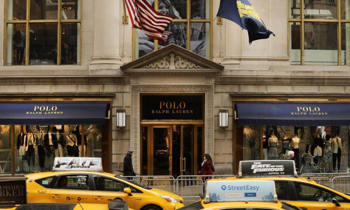 People walk by  Ralph Lauren's Fifth Avenue Polo store in New York City on April 4, 2017. (Spencer Platt/Getty Images)