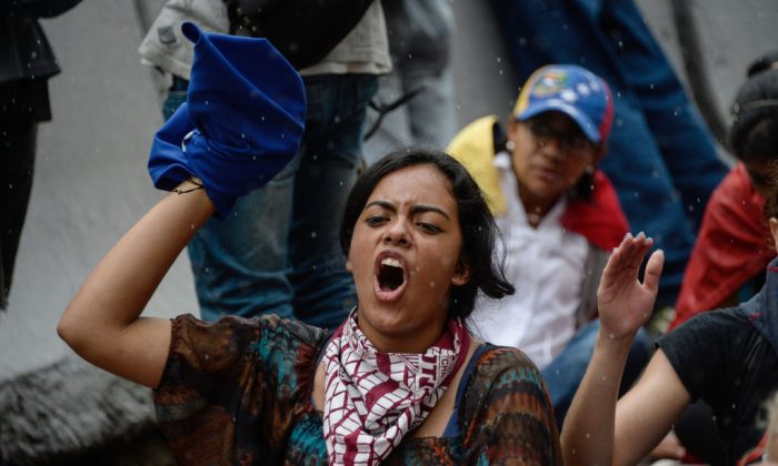 Opposition activists protest against the government in Caracas on May 12, 2017.(FEDERICO PARRA/AFP/Getty Images)