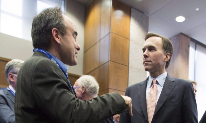 Finance minister Bill Morneau speaks with John Ruffolo, CEO of OMERS Ventures at the Munk School of Global Affairs in Toronto in 2016. Through supporting venture capital, the government aims to support innovative small companies in Canada.  (The Canadian Press/Peter Power)