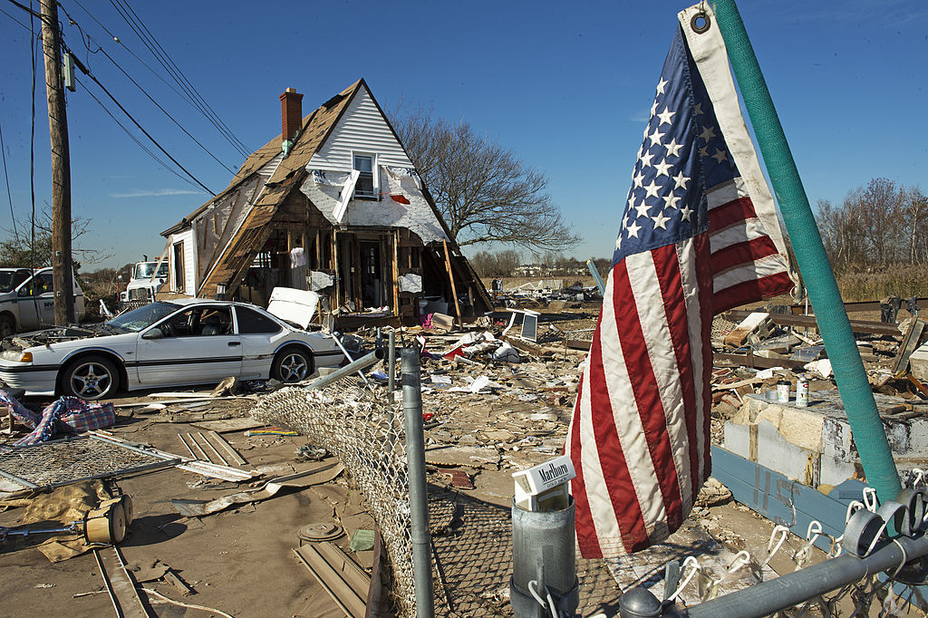 A house at 121 Kissam Ave is seen with its entire first floor washed away, as well as the entire surrounding area demolished  when Hurricane Sandy hit the coastal estuary in the Oakwood Beach area of  Staten Island, New York on Nov. 6, 2012. (PAUL J. RICHARDS/AFP/Getty Images)