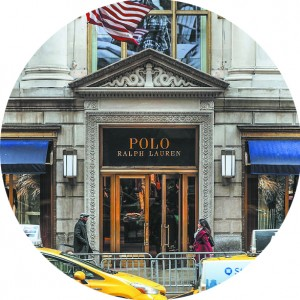 People walk by Ralph Lauren's flagship Fifth Avenue Polo store in New York City on April 4. (PHOTO BY GETTY IMAGES)