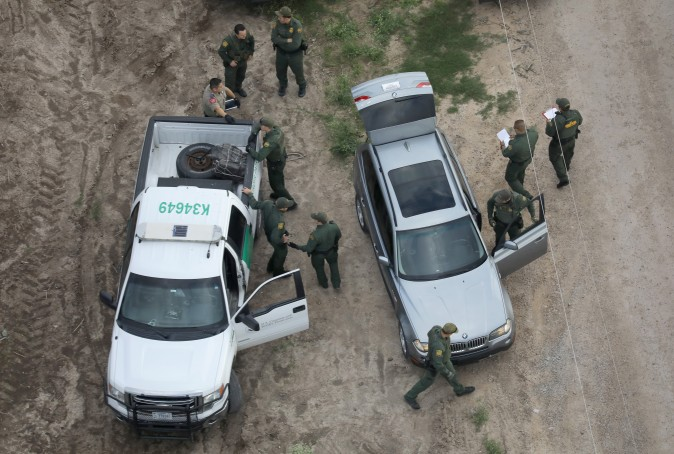 U.S. Border Patrol agents and Texas state troopers seiize bundles of marijuana during a drug bust on a BMW on March 15, 2017 in McAllen, Texas. (John Moore/Getty Images)