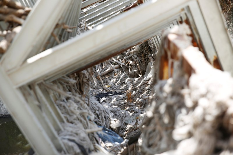 Discarded baby wipes and other garbage that flowed together with sewage are seen on a structure in the Kidron Valley, on the outskirts of Jerusalem July 6, 2017. (REUTERS/Ronen Zvulun)