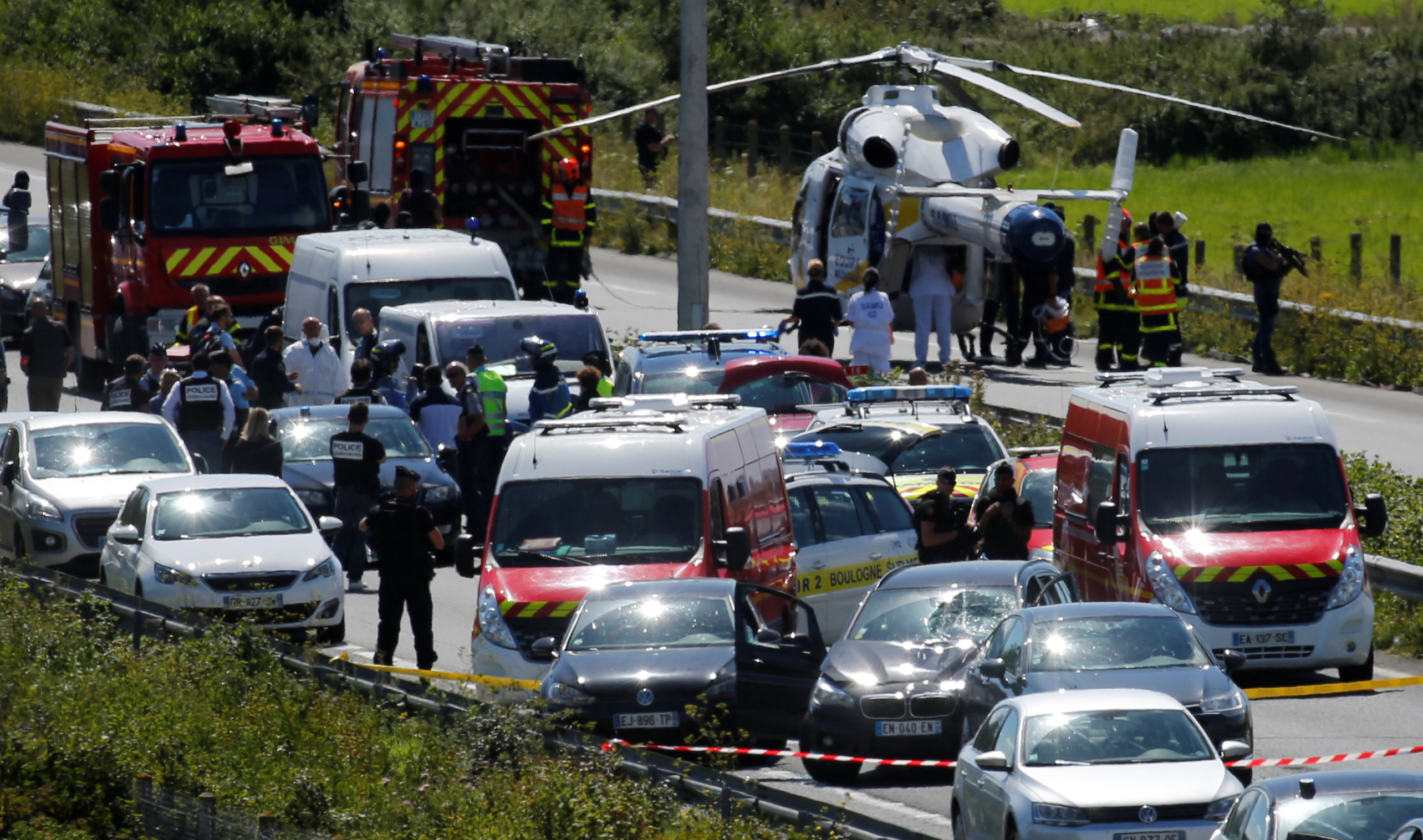Police and rescue forces are seen on the scene where the man suspected of ramming a car into a group of soldiers on Wednesday in the Paris suburb of Levallois-Perret was shot and arrested on the A16 motorway, near Marquise, France on Aug. 9, 2017.  (REUTERS/Pascal Rossignol)