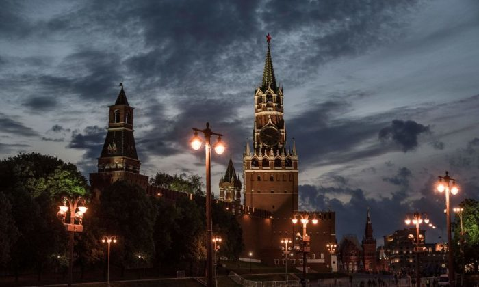 The sun sets behind the Kremlin at the Red Square in Moscow on June 8, 2017. (MLADEN ANTONOV/AFP/Getty Images)
