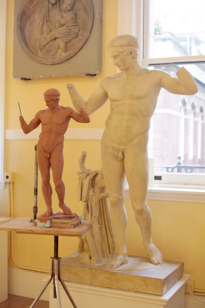 Charlie Mostow's copy (L) of  a cast of the Diadumenos by Polycletus (5th Century BCE) at the Institute of Classical Architecture and Art in New York. (Courtesy of Charlie Mostow)