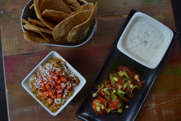 Chipotle pineapple guacamole and al pastor wings at Añejo. (Courtesy of Añejo)