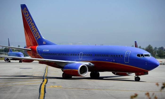 A Southwest Airlines Boeing 737-700 passenger jet taxis on the tarmac after arriving at Los Angeles International Airport on April 5, 2011, in Los Angeles. (Kevork Djansezian/Getty Images)