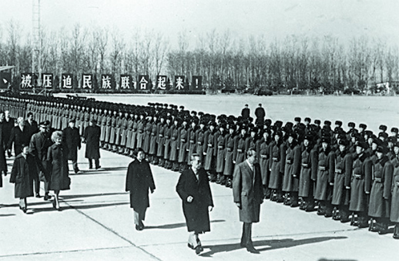 President Richard Nixon (R) and Chinese Premier Zhou Enlai inspect the honor guard at the Beijing Capital Airport on Feb. 22, 1972. (KEYSTONE/GETTY IMAGES)