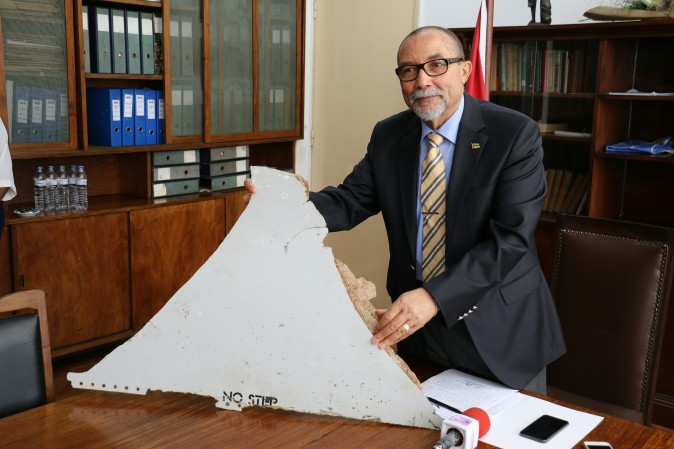 Joao de Abreu, President of Mozambique's Civil Aviation Institute (IACM), holds a piece of suspected aircraft wreckage of the Flight 370 found off the east African coast of Mozambique at Mozambique's Civil Aviation Institute (IACM) in Maputo on March 3, 2016. (ADRIEN BARBIER/AFP/Getty Images)