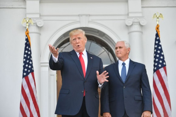 US President Donald Trump and Vice President Mike Pence speak to the press on August 10, 2017, at Trump's Bedminster National Golf Club in New Jersey before a security briefing. (NICHOLAS KAMM/AFP/Getty Images)